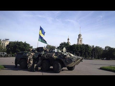 Slovyansk rebuilds as Ukraine rebels regroup in Donetsk