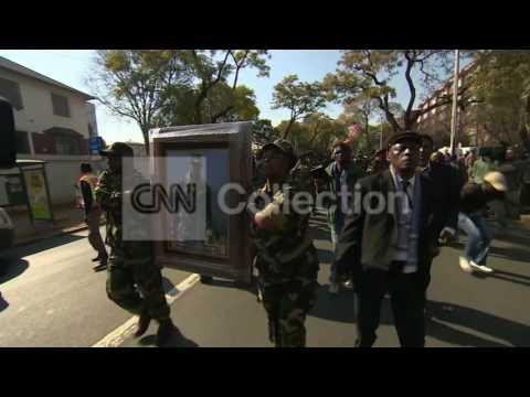 MANDELA: S AFRICA SOLDIERS SING OUTSIDE HOSPITAL
