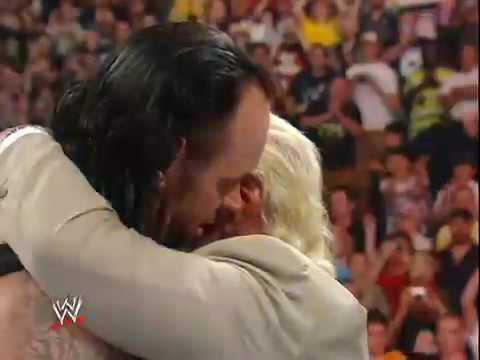 The undertaker and Vince hugs and says Goodbye to RIC FLAIR