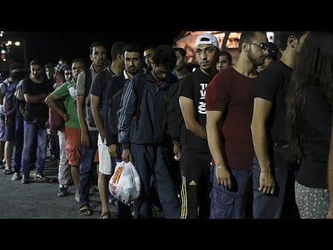 Syria refugees begin boarding Greek passenger ship in Kos