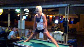 Sally doing the splits....on a pool table.