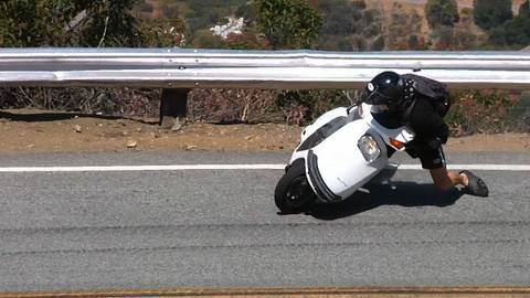 Scooter Crashes Into Guardrail on Mulholland