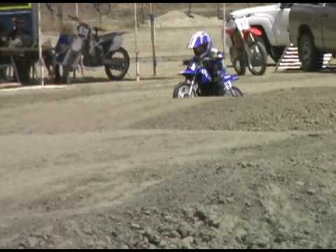 3 Year old riding at motocross track.