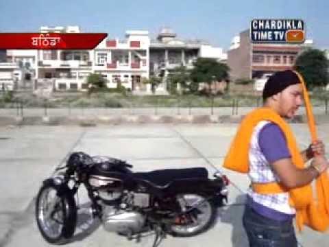 Turban Coach Manjeet Singh Ferozpuria tying turban with closed...