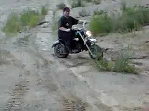 Doug deep in the sand on Baja  minibike