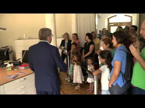 IOC President Thomas Bach shows Lausanne citizens around the IOC