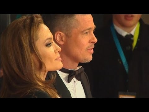 BAFTAs 2014: Brad Pitt and Angelina Jolie in matching tuxedos on the red carpet