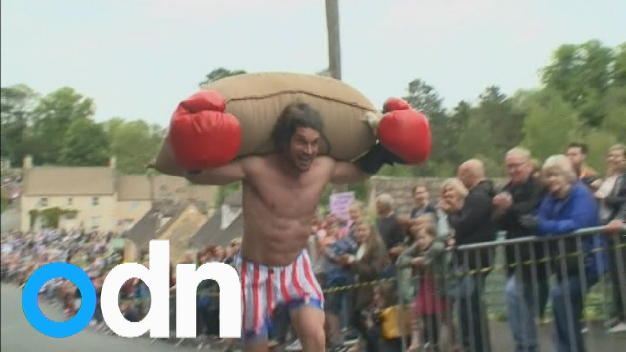 Quirky British runners race whilst carrying large sacks of wool