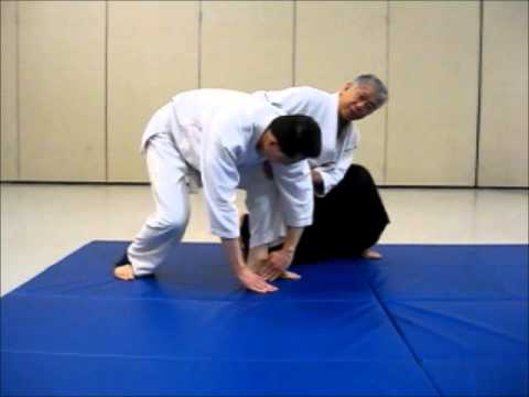 Instruction on teaching Aikido Mae Ukemi (forward rolls) Image 1