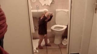 Baby playing in the toilete (hotel Bremene)