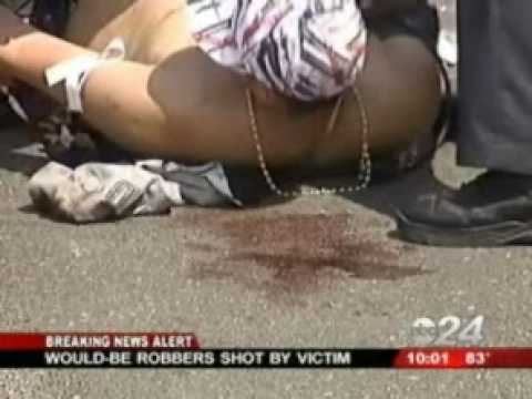 Jewelry Vendor Shoots Robbers (*Disturbing Images*)