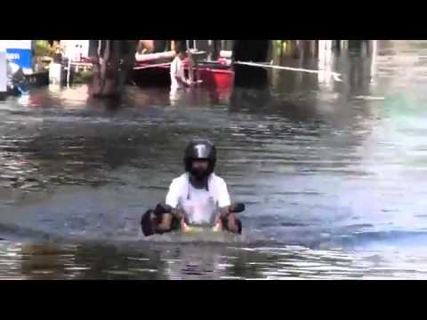 Motorbike Driver Ignores Flood
