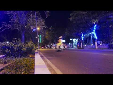 Night traffic on asian road, bikes and cars, stock footage