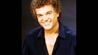 Watch Conway Twitty I Made You A Woman video