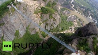 Drone footage: World's longest glass suspension bridge opens in China