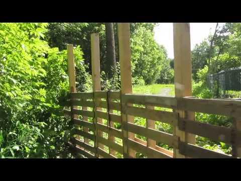 Construire une cl ture en bois de palette for Construire une cloture de jardin