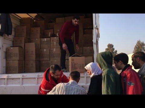 Aid convoy enters regime-besieged town near Damascus: ICRC (2)