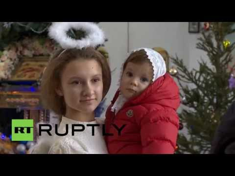 Russia: Ukrainian refugee children enjoy a Christmas ceremony in Moscow