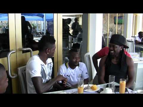 Funny Face in one of his hearty interactions with Emmanuel Adebayor