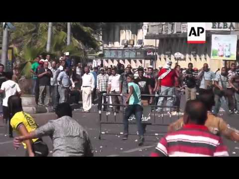 Clashes between supporters and opponents of Morsi; women at pro-army rally in Cairo