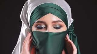 Portrait of an Arabic Young Woman with Her Beautiful Eyes in Traditional Islamic Cloth Niqab.  