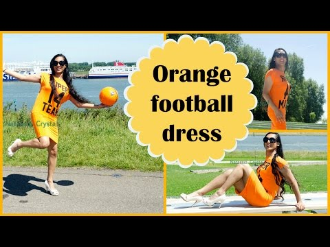Crossdresser - football in an orange dress and white peeptoe pumps