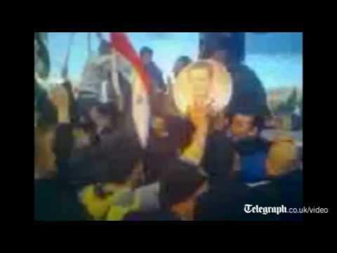 Amateur video purports to show pro-government crowds surrounding a convoy of ...