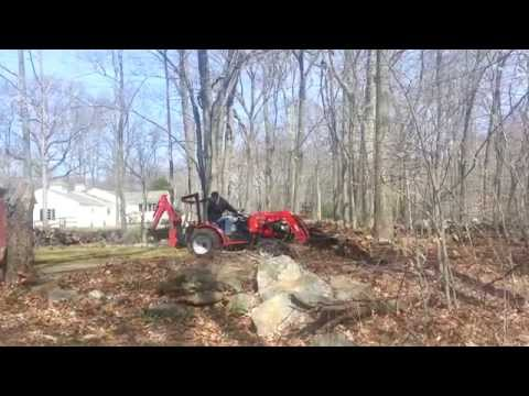 Mahindra Max 28XL Clearing land.