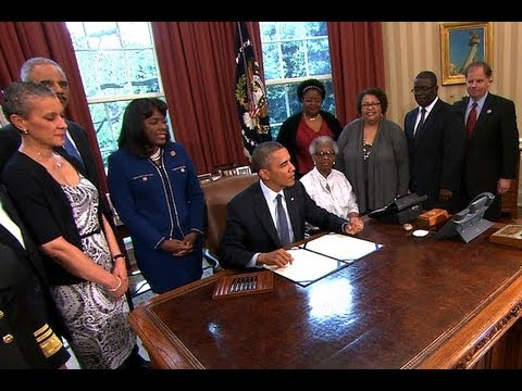 President Obama Signs a Bill Designating the Congressional Gold Medal