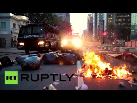 RAW: Police brutally clash with protesters at transport hike demo in Brazil