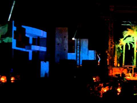 Large video projections on walls and trapeze artists from Sci-Fi Circus at an event in Egypt