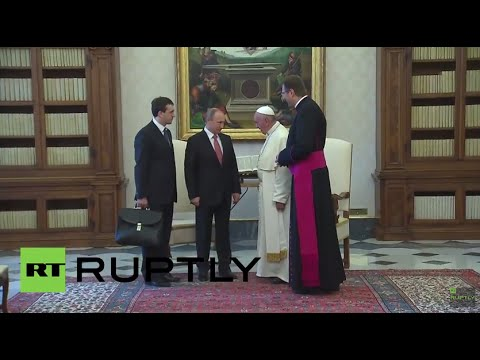 Holy See: Pope Francis greets Putin at the Vatican