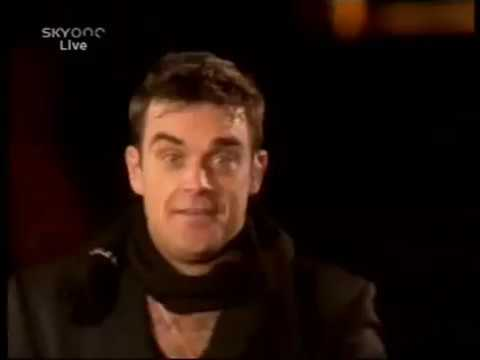 Robbie Williams falls