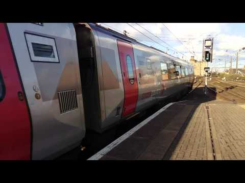 220034 and 220025 departing for Edinburgh