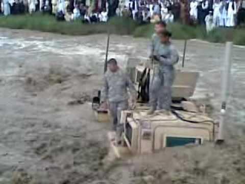 american soldier between the flood in Afghanistan.
