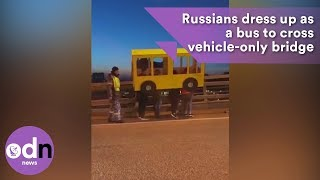 Group of Russians dress up as a bus to cross vehicle-only bridge