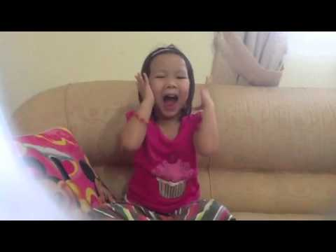 Little pinay girl sings row,row your boat