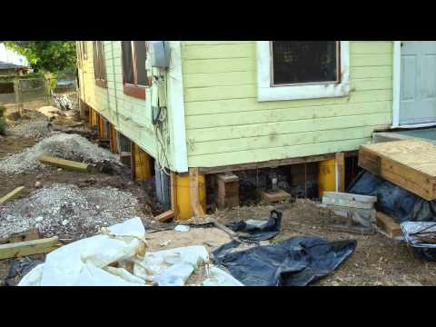 Leveling a house fix sinking foundation jacking level for Pier and beam foundation cost