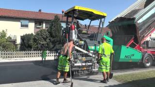 Volvo and Scania trucks delivering asphalt on a street outside Visby August 2015