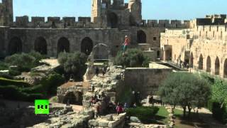 Daredevil performs thrilling splits above the ruins around Tower of David in Jerusalem