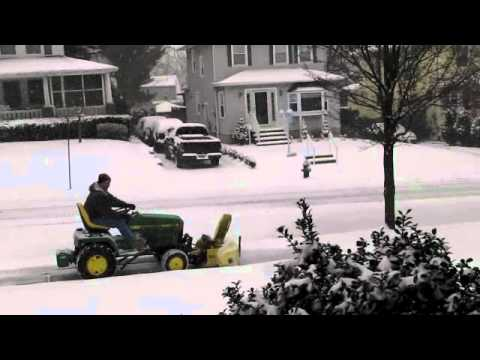John Deere 445 snow thrower removing snow