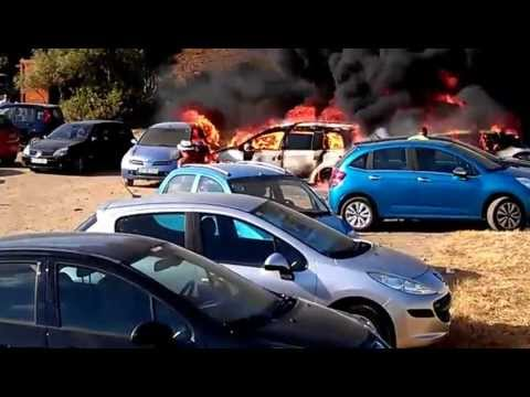 Menorca, burning cars on the beach parking. July 5, 2012