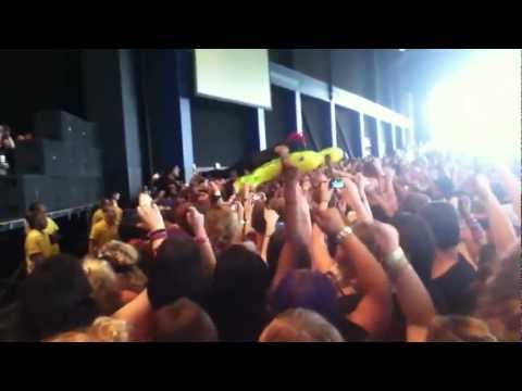 Dahvie crowd surfing on his turtle blow-up raft at Vans Warped Tour 2012