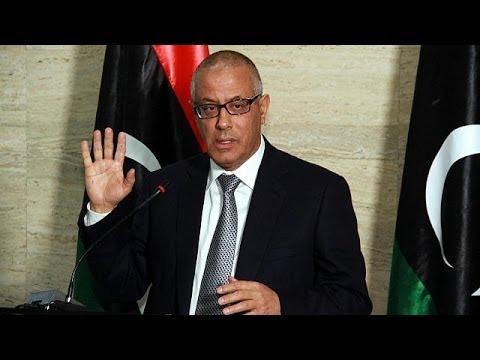 Libya dismiss PM as rebel held oil tanker breaks naval blockade