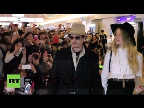 Japan: Johnny Depp and fiancee Amber Heard greet fans in Tokyo
