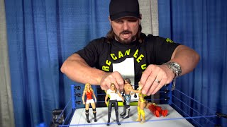 AJ Styles checks out Ronda Rousey's first WWE action figure