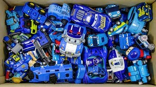 The box is full of blue toys and cars. I have a bunch of funny friends