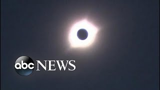 Crowds at Carhenge in Nebraska eager to view solar eclipse