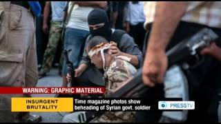 Time Magazine Publishes Photos of Decapitation by Takfiris in Syria