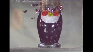 SUPER SLOW MOTION: Crushing art glass with hydraulic press